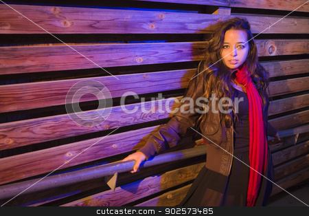 Mixed Race Young Adult Woman Against a Wood Wall Background stock photo, Portrait of a Pretty Mixed Race Young Adult Woman Against a Wood Wall Background. by Andy Dean