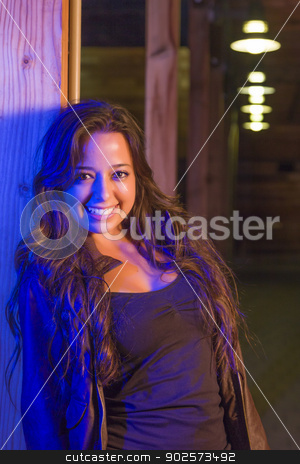 Night Portrait of Pretty Mixed Race Young Adult Woman stock photo, Night Portrait of Pretty Mixed Race Young Adult Woman Leaning Against a Wood Post. by Andy Dean