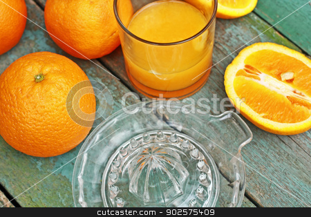 Making fresh orange juice  stock photo, Making fresh orange juice with glass juicer by Juliet Photography