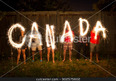 Canada sparklers in time lapse photography stock photo, The word Canada in sparklers in time lapse photography as part of Canada Day (July 1) celebration. by Click Images