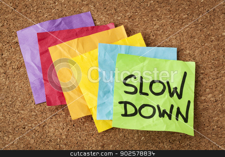 slow down - lifestyle concept stock photo, slow down - lifestyle concept or advice - handwriting on colorful sticky notes by Marek Uliasz