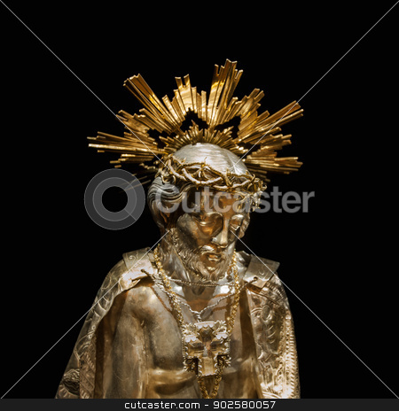 Jesus gold sculpture stock photo, 120 year old Jesus gold sculpture at Palma de Mallorca Cathedral on black background. by ifeelstock