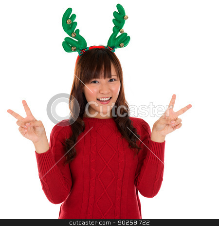 Asian Christmas girl showing victory sign. stock photo, Asian Christmas girl showing victory sign. Lovely young girl gestures v fingers smiling happy isolated on white background. by szefei