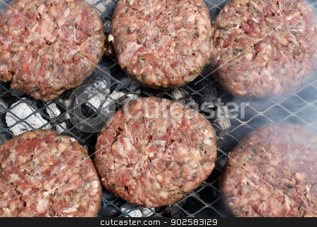 Burgers cooking on barbecue stock photo, Red meat burgers cooking on outdoor barbecue grill. by Martin Crowdy