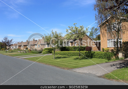 Houses on English street stock photo, Row of houses and bungalows on English street in rural village. by Martin Crowdy
