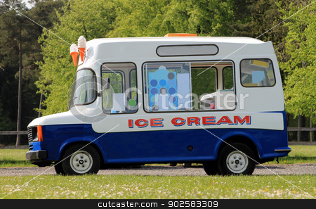 Ice cream van stock photo, Side view of ice cream van in green countryside by Martin Crowdy