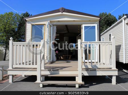 Luxurious modern caravan stock photo, Exterioer of luxurious modern caravan with open doors. by Martin Crowdy