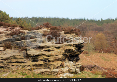 Rock formation in countryside stock photo, Eroded rock stack formation in countryside, North Yorkshire Moors National Park, England. by Martin Crowdy