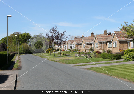 Street of bungalows stock photo, Street of bungalow houses in English Village. by Martin Crowdy