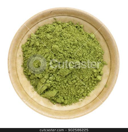 moringa leaf powder stock photo, moringa leaf powder in a small ceramic bowl, isolated on white, top view by Marek Uliasz