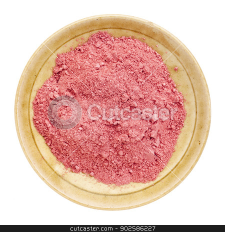 Organic yumberry powder stock photo, Organic yumberry powder on a small ceramic bowl, isolated on white, top view by Marek Uliasz