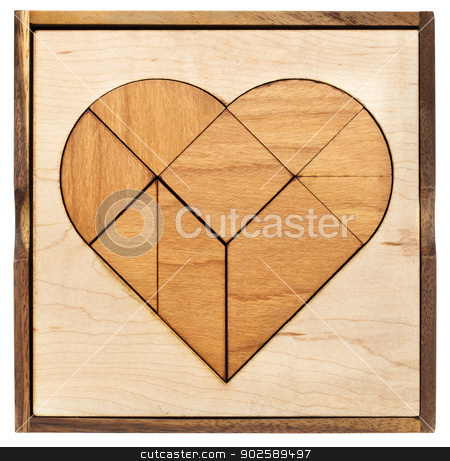 heart tangram stock photo, heart version of tangram, a traditional Chinese Puzzle Game made of different wood parts to build abstract figures from them, isolated on white by Marek Uliasz