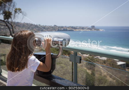 Young Girl Looking Out Over the Pacific Ocean with Telescope stock photo, Young Girl Looking Out Over the Pacific Ocean and La Jolla, California with Telescope. by Andy Dean