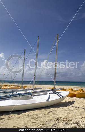 Beach Sail Boat stock photo, A personal sail boat on the beach by the ocean by Kevin Tietz