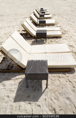Row of Beach Loungers stock photo, Rows of several lounge chairs on the beach by Kevin Tietz