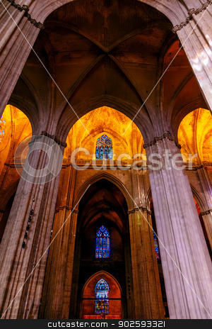 Stone Columns Stained Glass Cathedral of Saint Mary of the See S stock photo, Stone Columns Seville Cathedral, Cathedral of Saint Mary of the See, Seville, Andalusia Spain.  Built in the 1500s.  Largest Gothic Cathedral in the World and Third Largest Church in the World.  Burial Place of Christopher Columbus. by William Perry