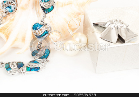 two pearl earrings and sea shells on white stock photo, two pearl earrings and sea shells isolated on white by Artush