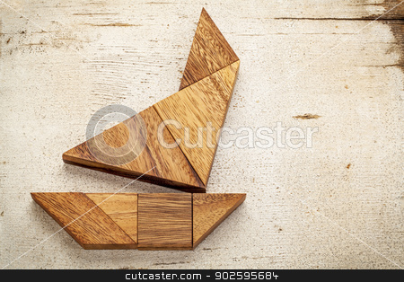 tangram sailboat stock photo, abstract picture of a sailing boat built from seven tangram wooden pieces over a rustic white painted barn wood by Marek Uliasz