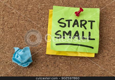 start small advice stock photo, start small -  business advice - handwriting on green sticky note by Marek Uliasz