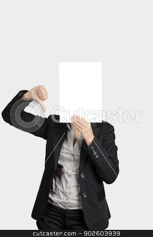 Paper face stock photo, Woman showing a blank paper sheet in front of her head and making a thumbs down gesture with the right hand  by ikostudio