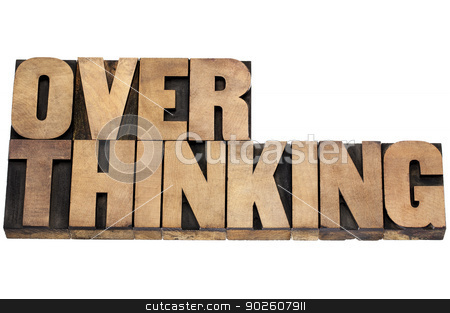 overthinking word in wood type stock photo, overthinking word - isolated text in letterpress wood type by Marek Uliasz