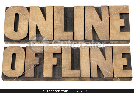 online and offline words stock photo, online and offline words - internet concept - isolated text in letterpress wood type by Marek Uliasz