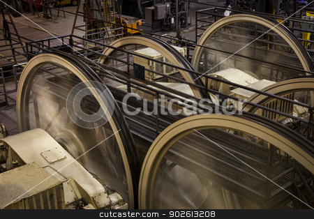 power house with running wheels stock photo, old dark power house with running wheels, steel cables and electric engines by Marek Uliasz