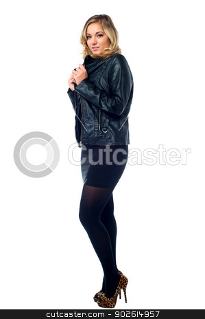 Attractive young female model in leather jacket stock photo, Stylish young female in leather jacket isolated over white background by Ishay Botbol