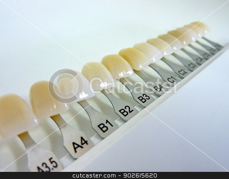 Dental shade guide stock photo, Dental shade guide with many colors for dental technician and dentist by Elenarts