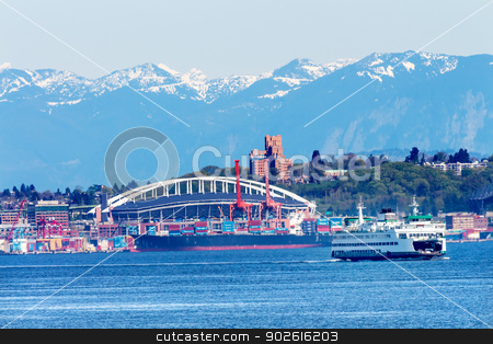 Seattle Washington Port Ferry Stadium with Cranes and Freighters stock photo, Seattle Washington Port Ferry with Cranes Containers and Freighters Ships at Pier to Be Unloaded and Stadium Cascade Mountains by William Perry