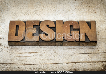 design word in wood type stock photo, design word in vintage letterpress wood type on a grunge painted barn wood background by Marek Uliasz