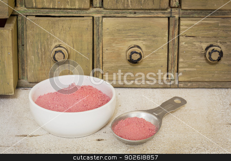 yumberry fruit powder stock photo, yumberry fruit powder - bowl and measuring tablespoon  with a primitive apothecary drawer cabinet in background by Marek Uliasz