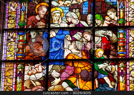 Nativity Mary Joseph Baby Jesus Stained Glass Cathedral of Saint stock photo, Nativity Mary Joseph Baby Jesus Stained Glass Created 1534 Seville Cathedral, Cathedral of Saint Mary of the See, Seville, Andalusia Spain.  Built in the 1500s.  Largest Gothic Cathedral in the World and Third Largest Church in the World.  Burial Place of Christopher Columbus. by William Perry
