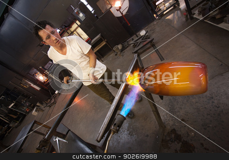 Glass Worker with Vase and Blowtorch stock photo, Glass factory worker holding vase near hot blowtorch by Scott Griessel
