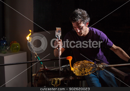 Man Decorating Glass Jar stock photo, Worker using pliers and rod to decorate glass object by Scott Griessel