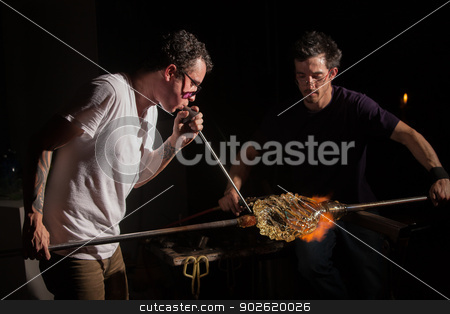 Workers Forming Glass Art stock photo, Glass industry artists working with blowpipe and blowtorch by Scott Griessel