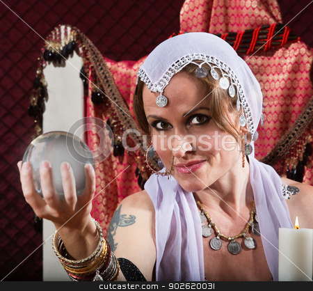 Gorgeous Fortune Teller stock photo, Gorgeous female fortune teller holding a crystal ball by Scott Griessel