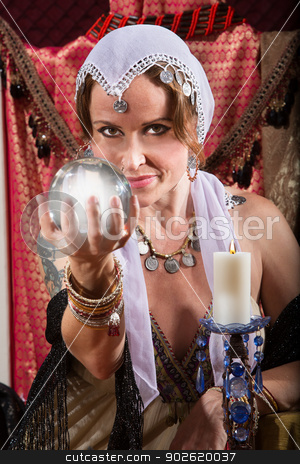 Grinning Fortune Teller stock photo, Grinning female fortune teller holding a crystal ball by Scott Griessel