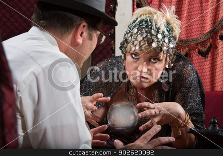 Lady Reading a Crystal Ball stock photo, Serious Caucasian fortune teller reading a crystal ball by Scott Griessel