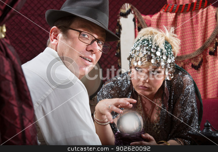 Businessman with Fortune Teller stock photo, Businessman with eyeglasses with crystal ball fortune teller by Scott Griessel