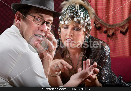 Startled Man with Palm Reader stock photo, Startled male with gypsy palm reader holding his hand by Scott Griessel