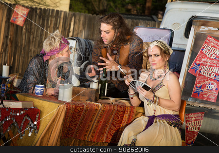 Fortune Telling Outdoor Kiosk stock photo, Group of gypsies outside meeting at fortune teller stand by Scott Griessel