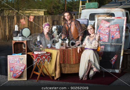Trio of Fortune Tellers stock photo, Three serious fortune tellers sitting outside at kiosk by Scott Griessel