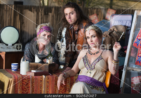 Fortune Tellers Sitting Outside stock photo, Three good looking fortune tellers outside with magic lamp by Scott Griessel