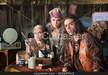 Trio of Fortune Tellers stock photo, Three fortune teller friends sitting at outdoor kiosk by Scott Griessel