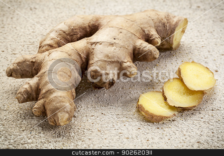 ginger root slices stock photo, ginger root slices on a rustic white painted barn wood background by Marek Uliasz