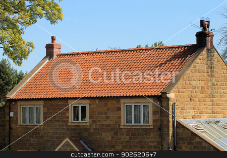 Brick house with red roof tiles stock photo, Exterior of brick house with red roof tiles, England. by Martin Crowdy