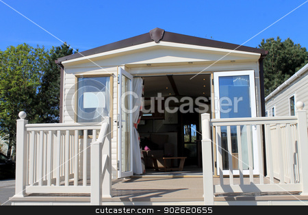 Caravan in trailer park stock photo, Open luxurious caravan in modern trailer park. by Martin Crowdy