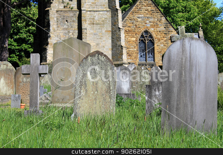 Old graves in cemetery stock photo, Old graves in cemetery with church in background, England. by Martin Crowdy