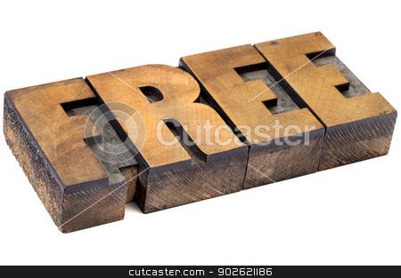 free word in wood type stock photo, free  - isolated diagonal word in vintage letterpress wood type by Marek Uliasz